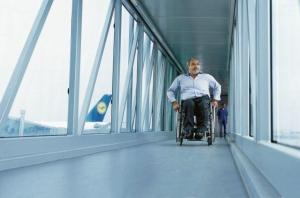 Passenger-bridge-view-of-a-man-sitting-in-a-wheel-chair-©-Jens-Goerlich-300x198
