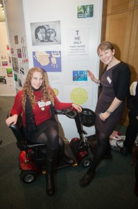 Caroline Lucas MP and Leader of the Green Party stood next to Shana Pezaro and her artwork. Shana is a disability and MS campaigner and contributed her own powerful piece of artwork.