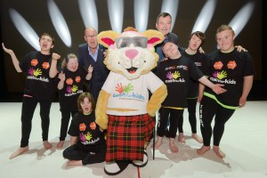 'King's panto stars Andy Gray (left) and Grant Stott (right) with pupils from Pilrig Park School and the Cash for Kids mascot, Courage the Cat, launching the first ever 'relaxed performance' of the King's panto. Photo by Phil Wilkinson.