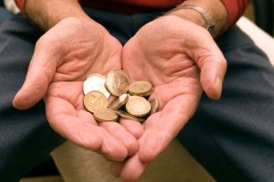 PAY-elderly-man-holding-coins