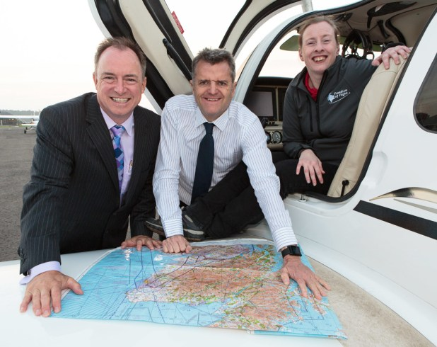 Andy Lothian (left), Paul Barnett and Pauline Gallagher check over the route of flight relay. Pic: ASM Media & PR