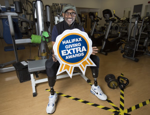Derek Campbell celebrates winning the local Halifax Giving Extra Awards for East London.