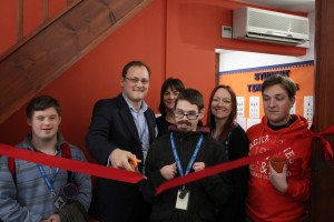 'Bristow representatives cutting the ribbon to open Baseline'. From left to right: Orpheus student Jamie Jackson, James Howell-Richardson (Bristow), Sheena Wilde (Bristow), Orpheus student Josh Ball, Orpheus Head of Fundraising Jo Bega, Orpheus student Thomas Puttock.