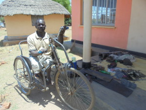 Leonard Cheshire work skills training beneficiary Issa Gabriel, a polio survivor, at his work place in Uganda