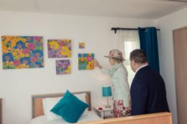HRH admires Tom Yendell's own pictures in Flat Spaces Twin room with electric profiling beds