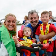 family of '4' after  finishing a sports event designed for disabled people