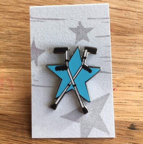 Two crossed crutches over a blue star.