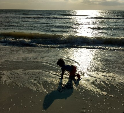 Child playing freely in beach