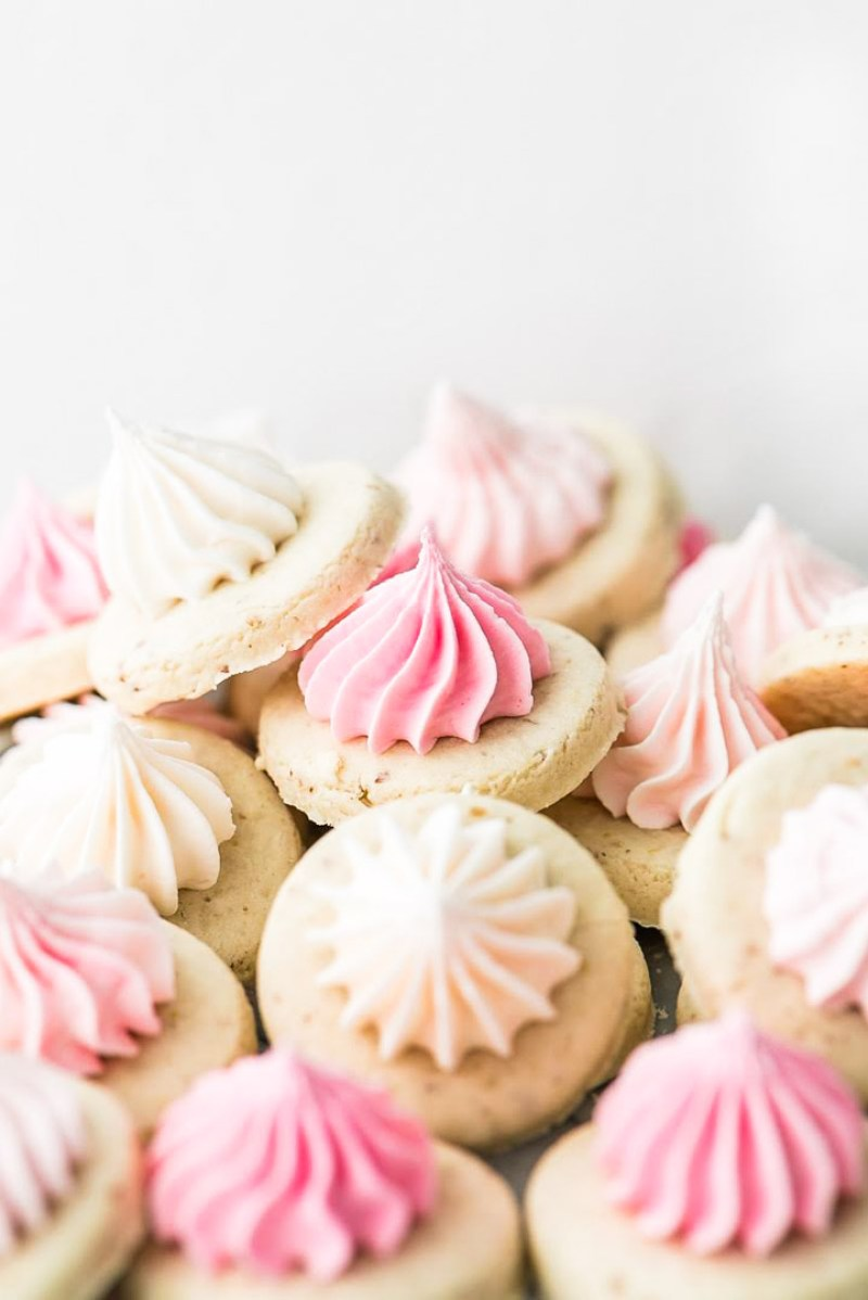 pretty pink sugar cookies recipe decorated with stiff royal icing. Dairy and gluten free.