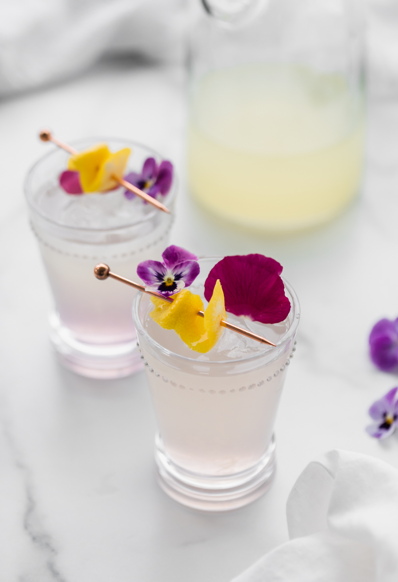 Spiked lemonade cocktail recipe, infused with creme de violette liqueur for spring and summer entertaining.