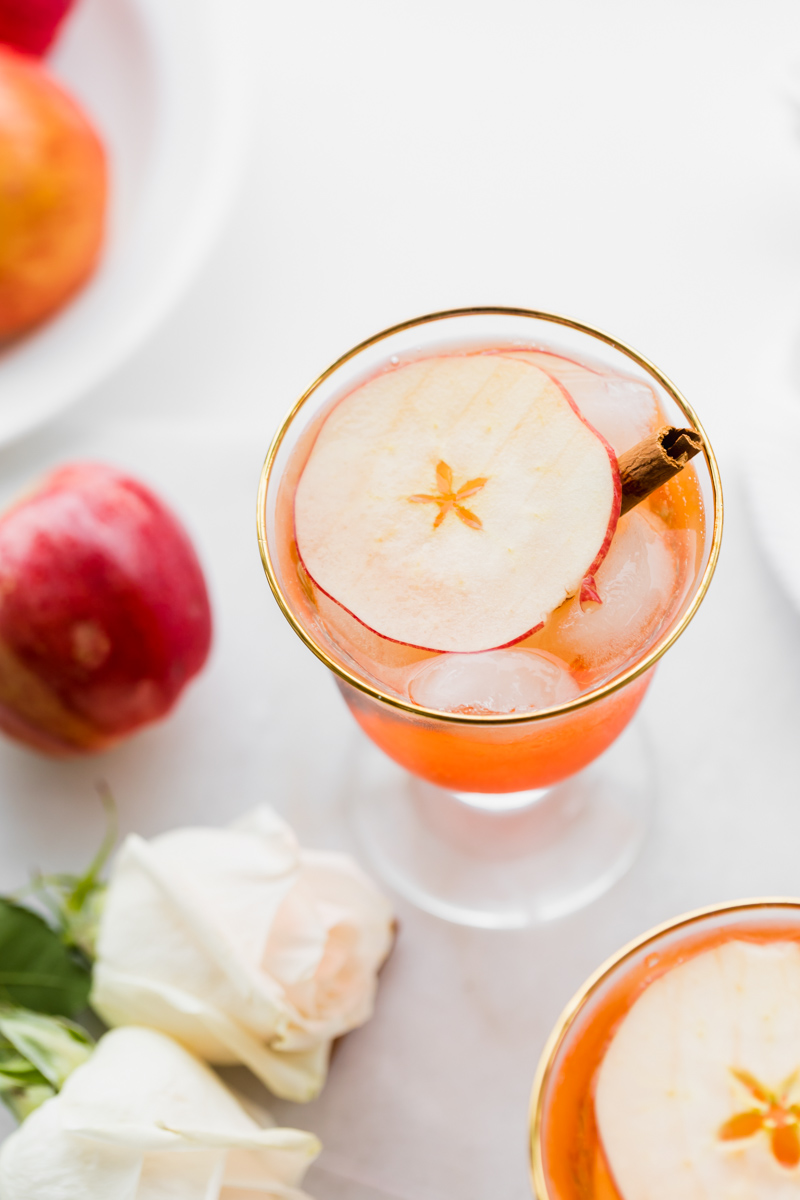simple fall cocktail recipe for hard apple cider Aperol Spritz with apples and cinnamon
