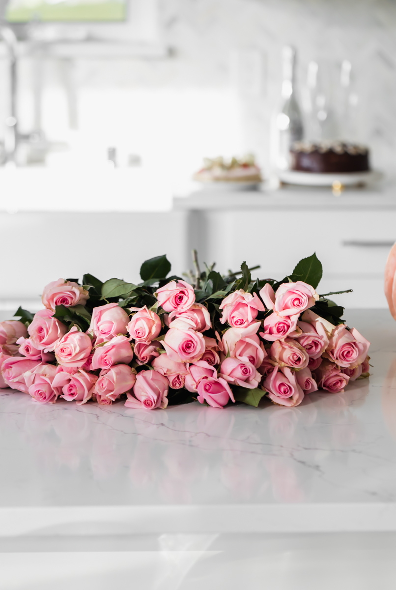 pink roses in a white kitchen