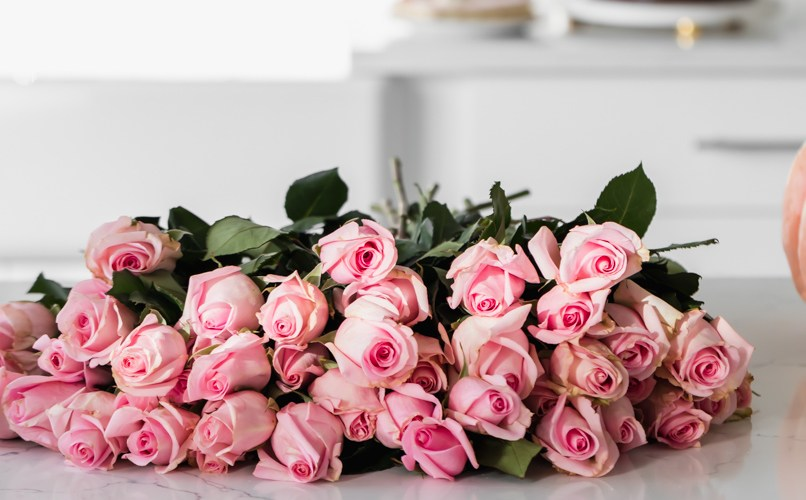 pink roses in white kitchen