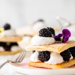 An easy and quick recipe for vegan Napoleon/mille feuille with puff pastry, coconut whip and fresh blackberries.