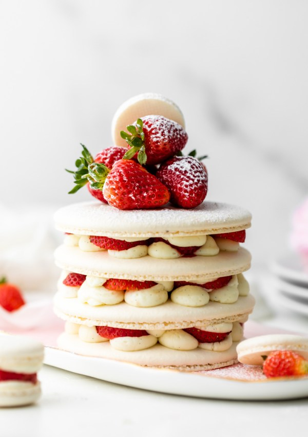 Recipe and instructions for this Fresh and delicious Strawberry Shortcake Macaron cake complete with garden strawberries, and vanilla filing. Dairy and gluten free summer recipe