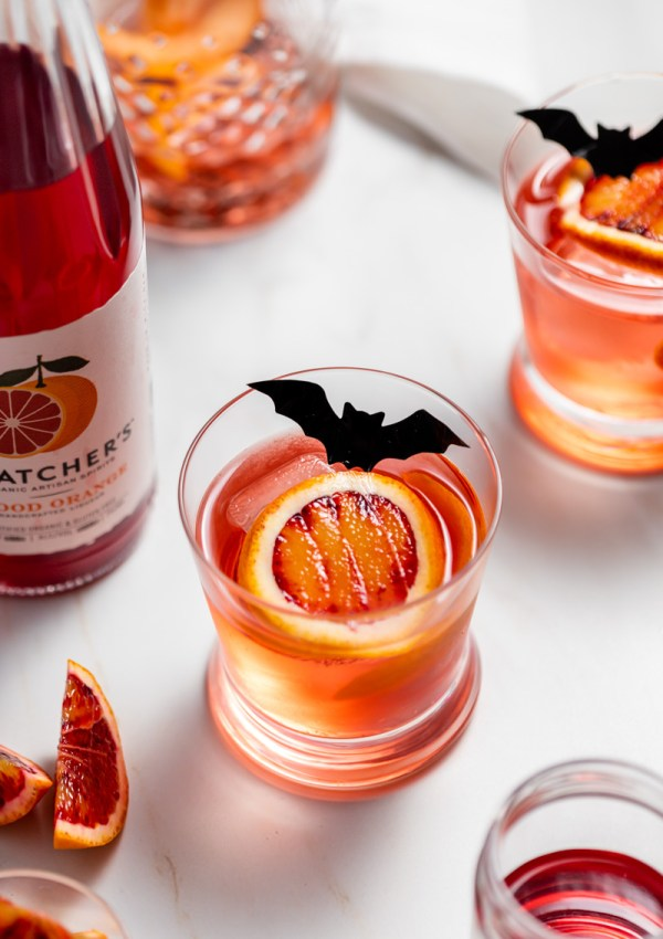 A twist on the classic Negroni infused with Blood Orange liqueur from Thatcher's Organic, and fresh blood orange, served on the rocks with dry ice and bats for upcoming fall and halloween!