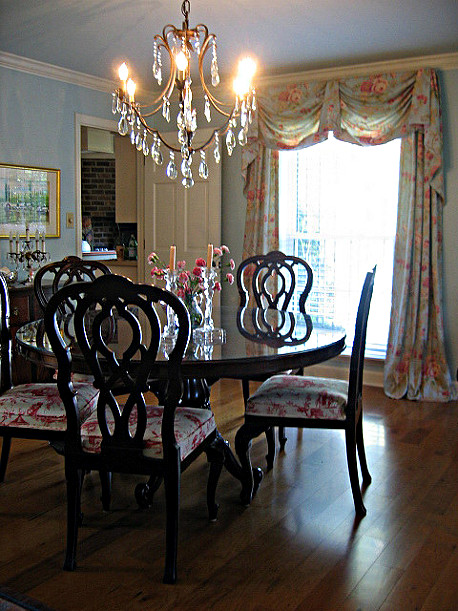 Formal dining room in British colonial style - exotic toile, flowers and mahogany.