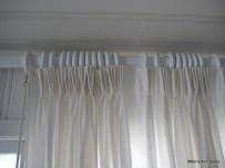 Pinch pleats, unlined white linen on heavy wood rod, ocean front