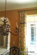 Tuscan style, floral linen, glazed walls and iron work