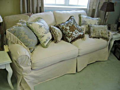 2 cushion sofa with pillows