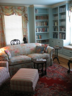 Custom English style library with painted floor-to-ceiling cabinetry