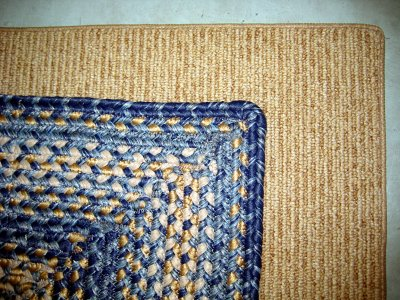 Nylon rugs that look like sisal or braided cotton.