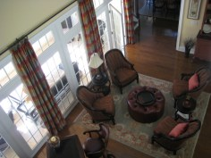 The great room with silk plaid draperies and Oushak carpet