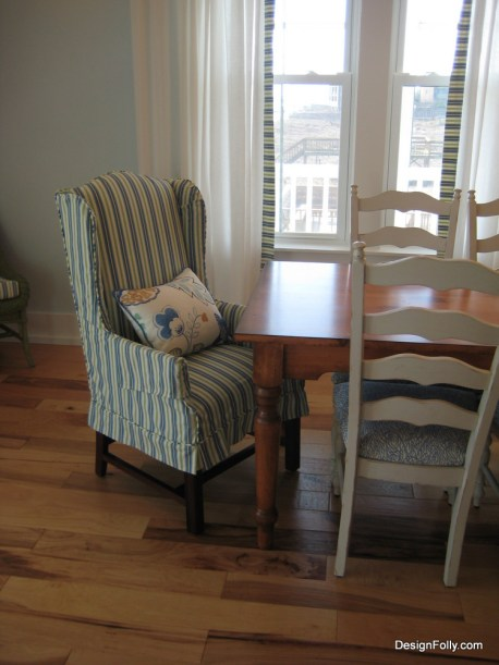 The custom dining table is made from reclaimed wood, and the side chairs as well. Slipcovered end chairs are washable.