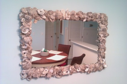 A custom oyster shell mirror in the dining area