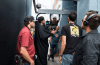 dp-matt-mayotte-holding-the-camera-with-gaffer-cyrus-leaning-on-the-wall-and-boom-operator-david-behind-him