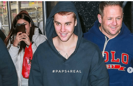 Justin Bieber smiling for paps makes us all smile.