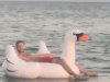 calvin-harris-chilling-on-a-swan-