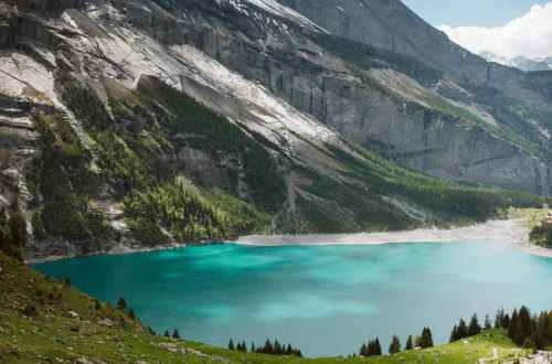 mountain ridge and lake on cloudy day