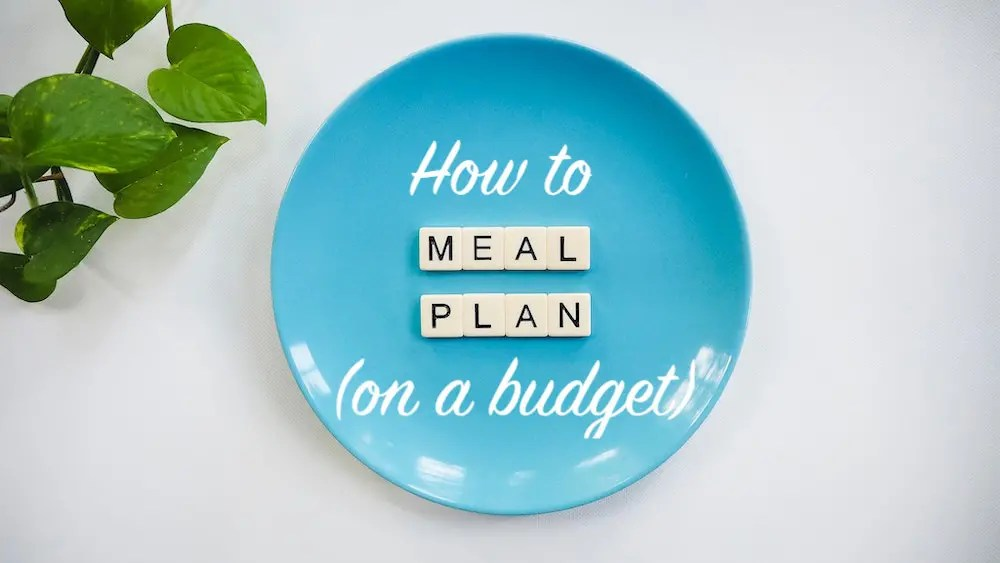 blue plate with scrabble tiles spelling meal plan_meal planning on a budget_positively nourishing nutrition consulting