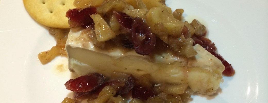 Brie topped with Apples and Craisins – Delicious!