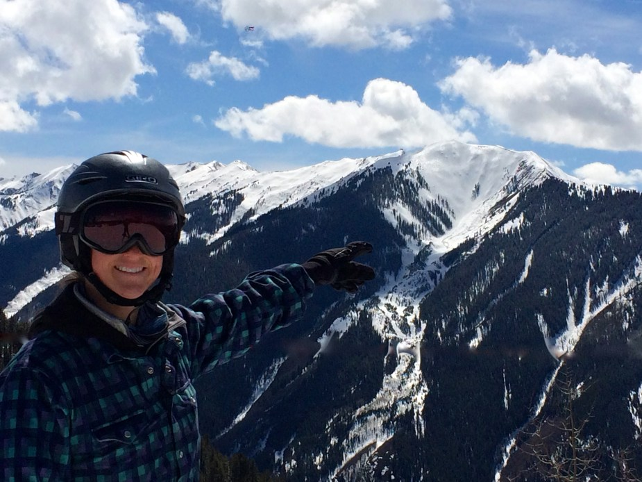 Alyssa pointing out Highlands Bowl across the way.