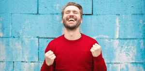 man smiling - Characteristics and Traits of a Positive Mindset: 6 Examples