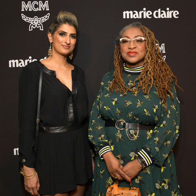 """Two women standing next to each other with a black background that reads, """"marie claire."""""""