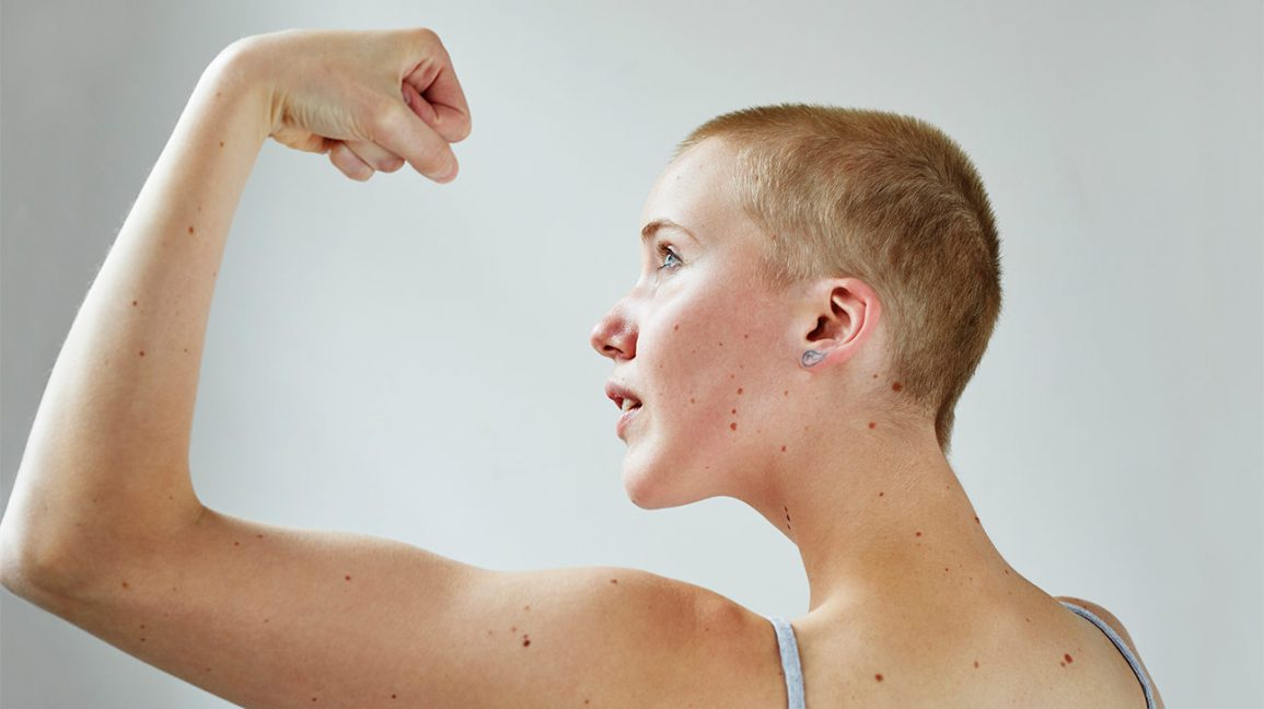 young person flexing their arm