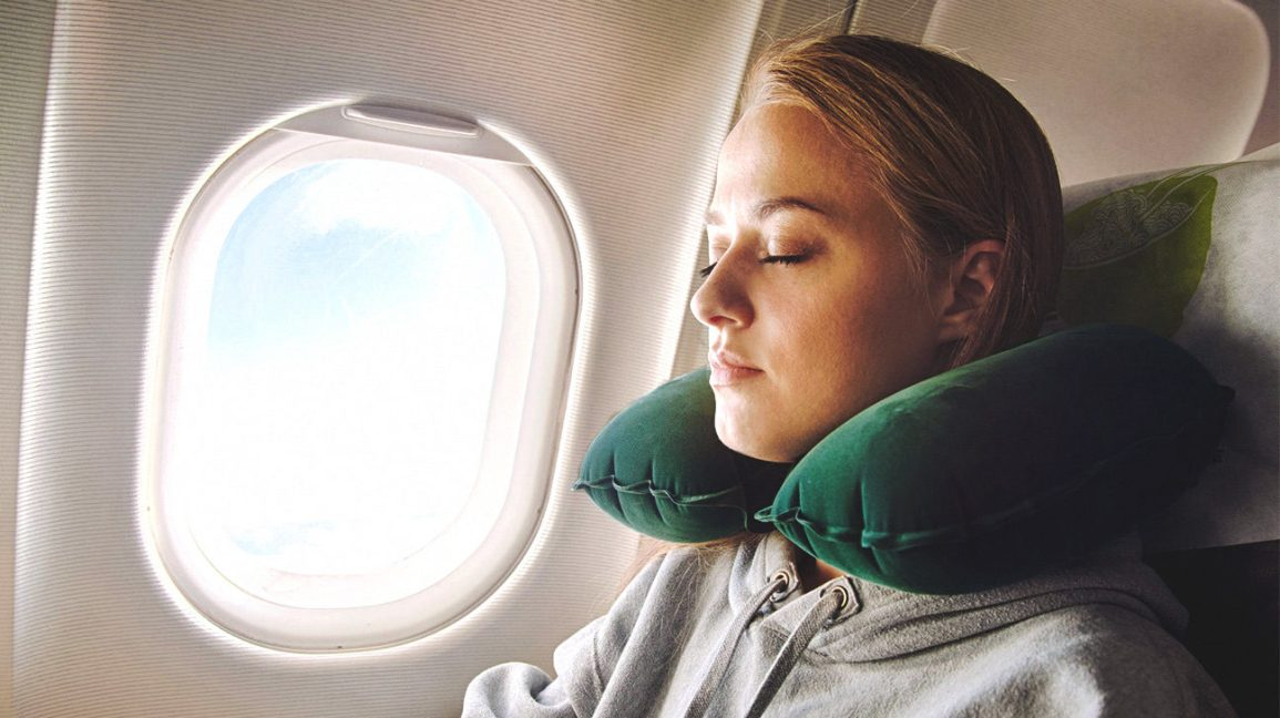 How to Sleep on a Plane: Where to Sit, What to Pack, and