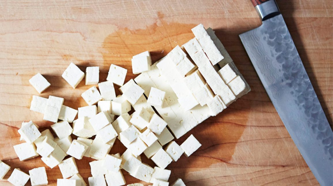 chopped squares of tofu on a table