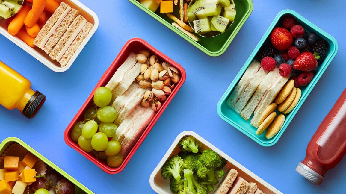 colorful Bento boxes on a blue table