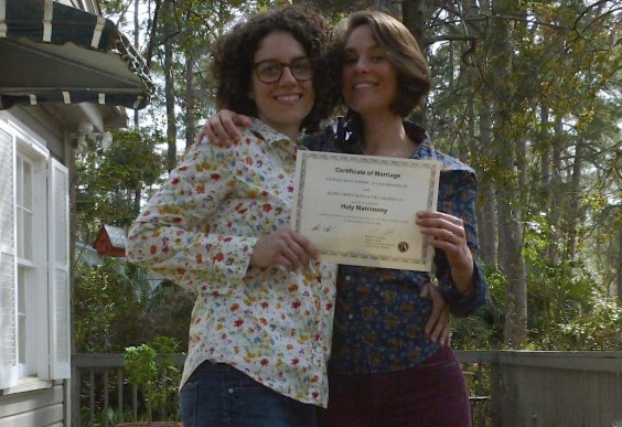 Kilby, the author, and her wife, Lindsay, with their marriage certificate