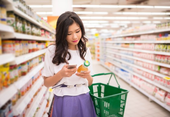 Woman Grocery Shopping With App