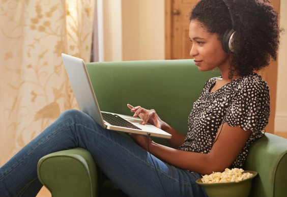 Woman on Laptop Eating Popcorn