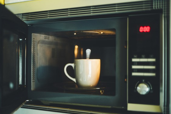 Mug and spoon in a microwave