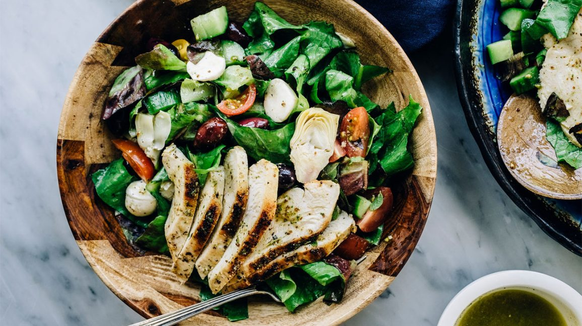 Grilled Mediterranean Chicken Salad In A Wooden Bowl