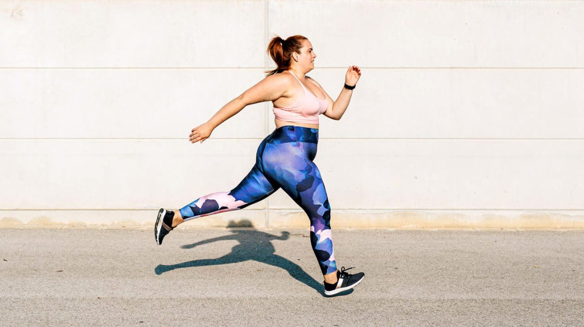 Stylish, overweight woman jogging