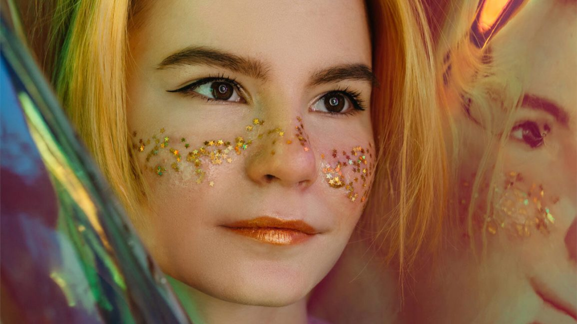 girl with glitter on her cheeks