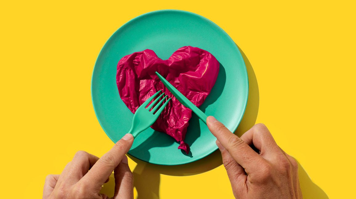 cutting a balloon heart on a plate
